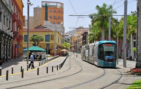 tramcar: Santa Cruz de Tenerife, Spain - June 23, 2011: Tram in a street of old town in Santa Cruz de Tenerife, Canary Islands, Spain. Tram was opened in 2007 and it is used by 50000 people daily.