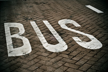 dashed: a bus lane painted on the street Stock Photo