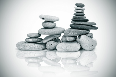 vignetted: a pile of zen stones on a vignetted background Stock Photo