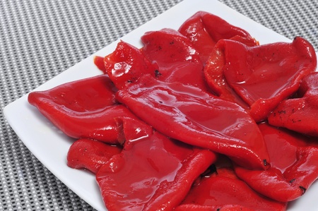 closeup of a pile of roasted piquillo peppers Stock Photo