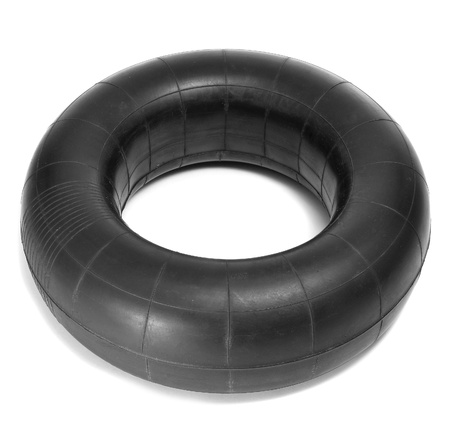 tubing: an old inner tube on a white background