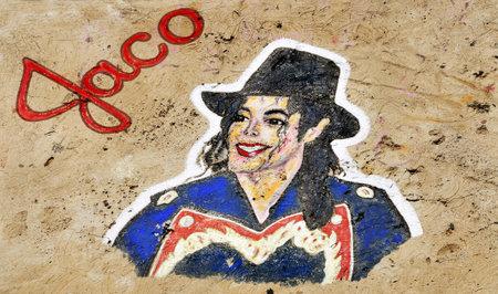 Santa Cruz de Tenerife, Spain - June18, 2011: A Michael Jackson graffiti on a stone of a breakwater in Santa Cruz de Tenerife, Spain. It tributes to the King of Pop, died on June 25, 2009.