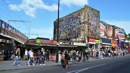 bric: London, United Kingdom - May 8, 2011: Shops in Camden Street in London, UK. Camden Market and streets nearby are the fourth-most popular visitor attraction in London, attracting approximately 100,000 people each weekend
