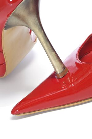 patent leather: closeup of a pair of women pointy red patent leather shoes