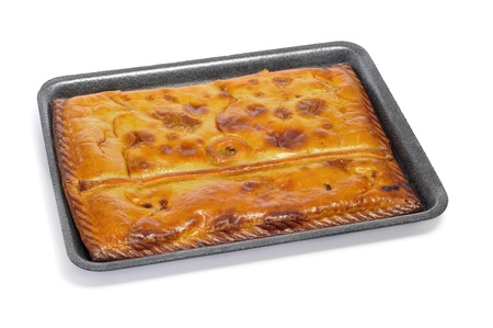 an empanada gallega, a typical cake stuffed with tuna or meat, from Galicia, Spain