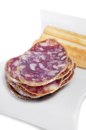 embutido: tapa of salchichon, spanish salami, served with breadsticks Stock Photo