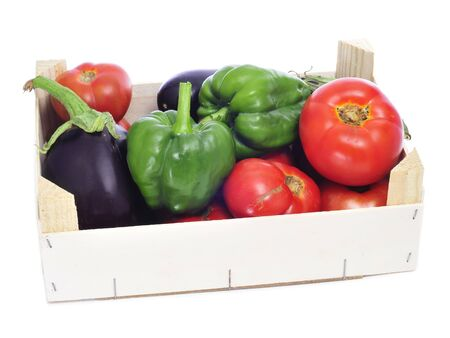a crate with organic vegetables as green peppers, eggplants and tomatoes photo