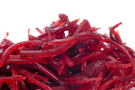 grated: a pile of grated beet on a white background