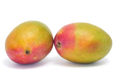 caribbean food: some mango fruits on a white background Stock Photo