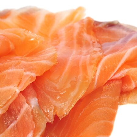 closeup of some slices of smoked salmon on white background