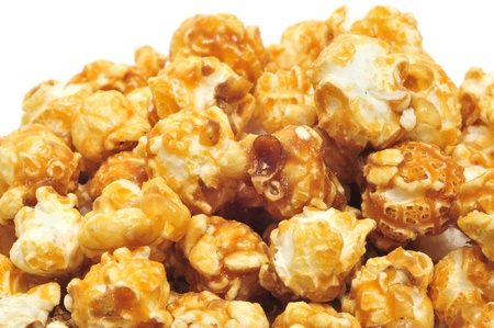 theater popcorn: a pile of caramel corn on a white background Stock Photo