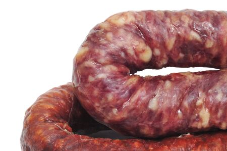 embutido: closeup of a spanish chorizo and a spanish fuet on a white background Stock Photo