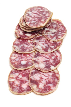 embutido: a pile of salchichon, spanish salami, on a white background