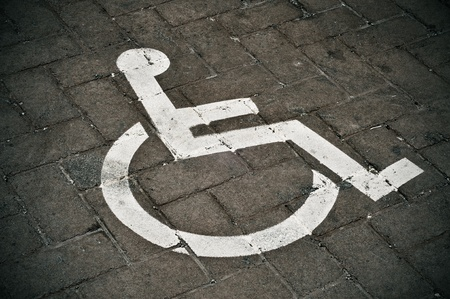 disabled parking sign: Disabled parking permit sign painted on the street