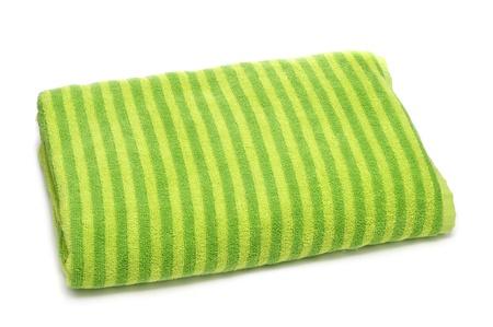 a folded striped beach towel on a white background photo
