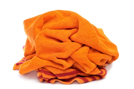 towelling: an orange beach towel on a white background