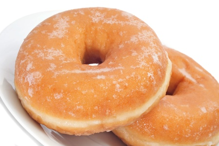 fattening: closeup of a pair of donuts on a plate
