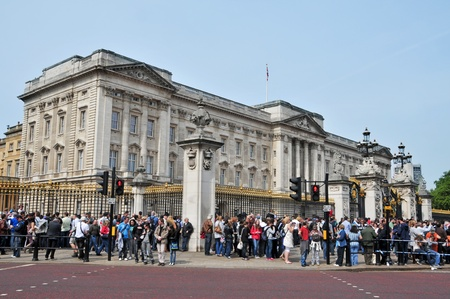 London, United Kingdom - May 6, 2011: A crowd waiting for the Changing of the Guard in Buckingham Palace in London, UK. This is one of most important attraction for visitors in London.