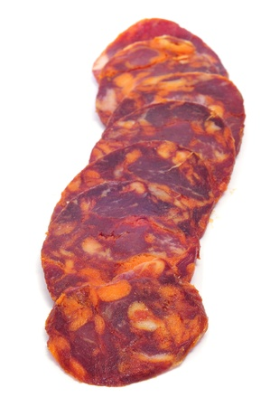 embutido: some slices of spanish chorizo on a white background