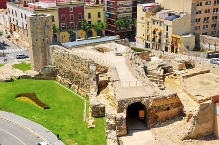 designated: Tarragona, Spain - May 14, 2011: Remains of Roman circus in Tarragona, Spain. The circus is part of Archaeological Ensemble of Tarraco which has been designated a World Heritage Site by UNESCO.