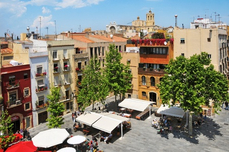 rei: Tarragona, Spain - May 14, 2011: Placa del Rei and old town with Cathedral at the background in Tarragona, Spain. This square, in the heart of Part Alta, the old town of Tarragona, is a meeting point in the city.