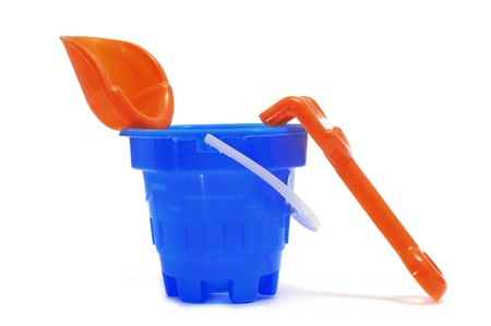 a castle bucket with shovel and rake on a white background photo