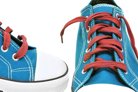 lace up: a pair of sneakers on a white background Stock Photo