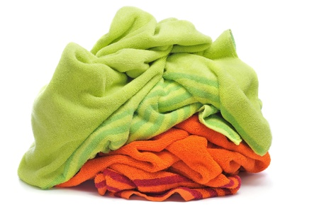 terrycloth: a pair of beach towels, one green and one orange, on a white background Stock Photo