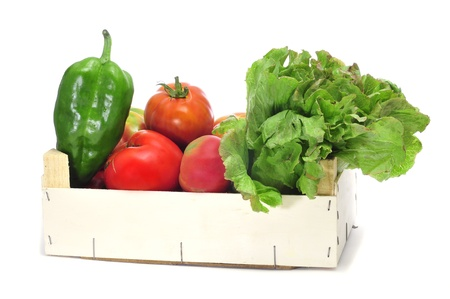 a crate with organic vegetables as green peppers, tomatoes ant lettuce photo