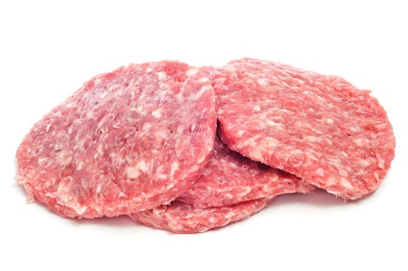 mincing: a pile of raw burgers on a white background Stock Photo