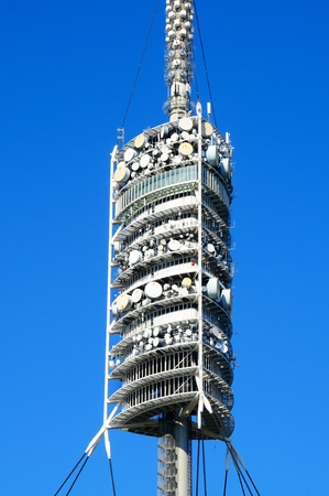 detail of a communications tower over the sky photo