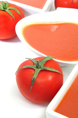 andalusian: bowls with spanish gazpacho on a white background