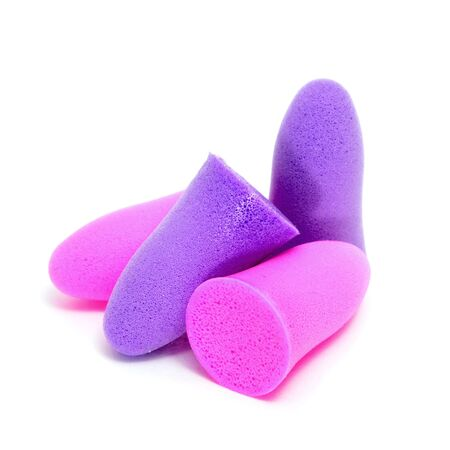 foam safe: foam earplugs of different colors on a white background Stock Photo