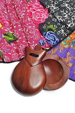 closeup of spanish castanets and hand fan on a white background photo
