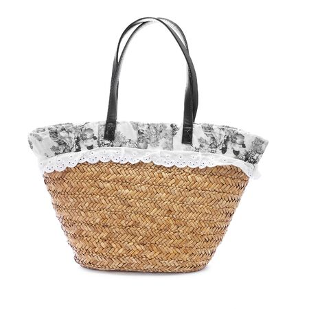 consumerist: a raffia shopping bag on a white background