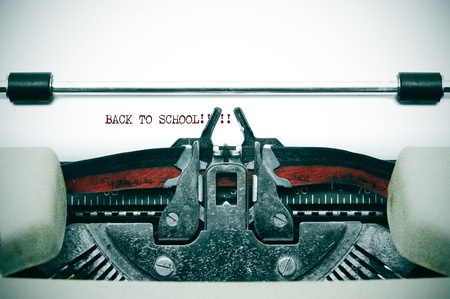 writers: back to school written with and old typewriter