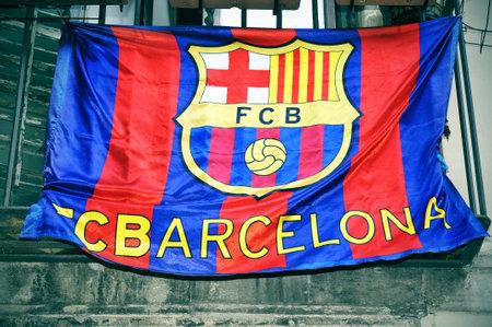 fanatical: a FC Barcelona flag hanging on a balcony Editorial