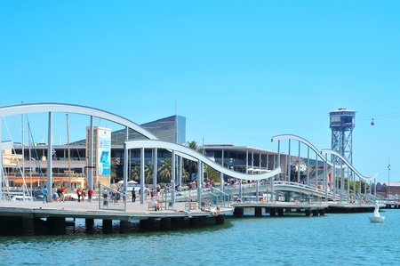 Barcelona, Spain - August 16, 2011: Rambla de Mar and Port Vell in Barcelona, Spain. The area has a leisure center, shops and restaurants called Maremagnum, an IMAX cinema and an aquarium