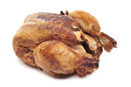 pollo rostizado: un pollo asado sobre un fondo blanco