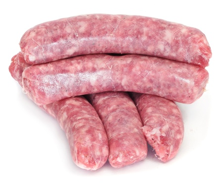 pork sausage: a pile of pork meat sausages on a white background Stock Photo
