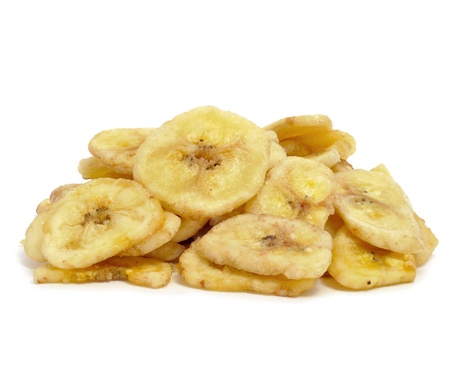 plantain: a pile of banana chips on a white background Stock Photo