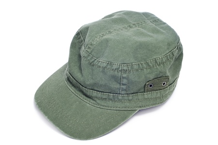 insolación: una gorra verde sobre un fondo blanco Foto de archivo