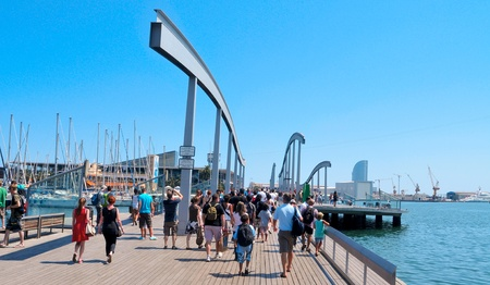 Barcelona, August 16, 2011: Rambla de Mar and Port Vell in Barcelona, Spain. The area has a leisure center, shops and restaurants called Maremagnum, an IMAX cinema and an aquarium