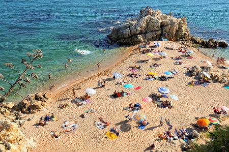 Sant Pol de Mar, Spain - August 17, 2011: La Roca Grossa Beach in Sant Pol de Mar, Spain. The Catalan coast, where is Sant Pol de Mar, is the destination of millions of tourists in the summer