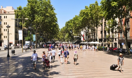 rambla: Barcelona, Spain - August 16, 2011: La Rambla in Barcelona, Spain. Thousands of people walk dayly by this popular pedestrian mall 1.2 kilometer-long