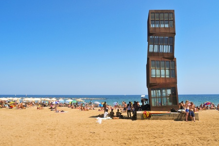 cor: Barcelona, Spain - August 16, 2011: Barceloneta Beach in Barcelona, Spain. The sculpture designed by installation artist Rebecca Horn in COR-TEN steel presides over this urban beach Editorial