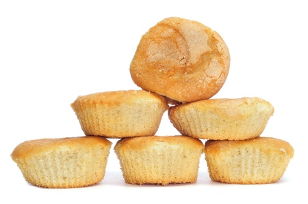 madalena: a pile of plain cupcakes on a white background Stock Photo