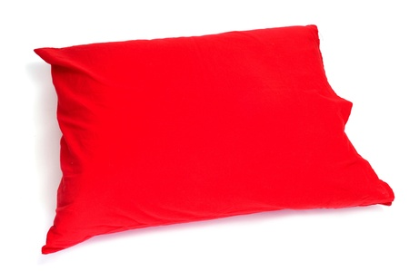pillow case: pillow with a red  pillow case on a white background Stock Photo