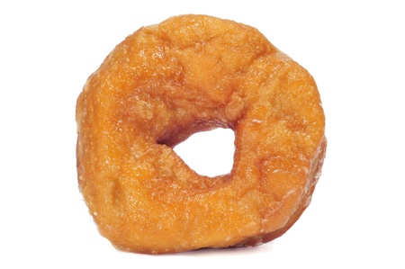 a homemade donut  on a white background photo