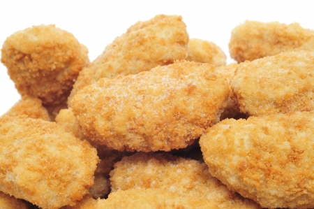 nugget: a pile of chicken nuggets on a white background